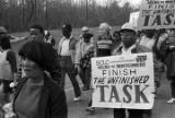 Marchers during the 20th anniversary reenactment of the Selma to Montgomery March, probably in rural Dallas or Lowndes County, Alabama.
