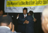 Jesse Jackson hugging Joseph Lowery at the annual meeting of the Southern Christian Leadership Conference (SCLC) in Birmingham, Alabama.