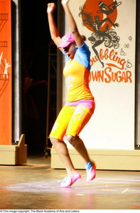 Dancer dressed in bright clothes Hip Hop Broadway: The Musical