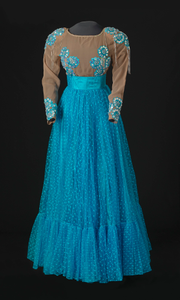 Turquoise blue dress with nude bodice and blue details designed by Peter Davy