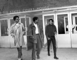 SNCC leaders H. Rap Brown, Stokely Carmichael, and George Ware leaving the U.S. Courthouse in Nashville, Tennessee, 1967 May 23