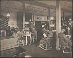 [African American soldiers reading, playing cards, and relaxing in Y.W.C.A. Hostess House]