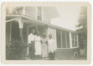 Digital image of men and women at the Taylor family home on Martha's Vineyard