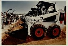 Earthmovers are lined up in preparation for ground breaking ceremonies, July 11, 1993