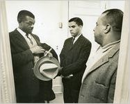 Hamilton Holmes, one of the first two African-American students to integrate the University of Georgia (center), with his attorney D.L. Hollowell (left), and his father Alfred Holmes, Athens, Georgia, January 9, 1961.
