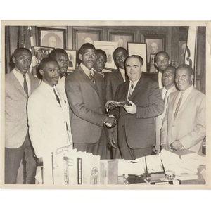 Thumbnail for Kivie Kaplan shakes hands with an unidentified male while Reverend Michael E. Haynes looks on.
