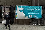 Woman exiting Woodhull Hospital, Marcus Garvey Blvd. by Broadway, Brooklyn