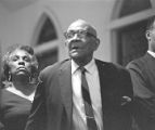 Audience standing at St. Paul AME Church in Birmingham, Alabama, probably listening to Martin Luther King, Jr., speak.