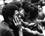 Two people look onward at a Black Panther Party convention