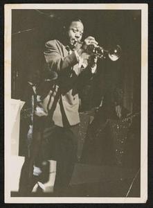 Roy Eldridge in front of saxophone section