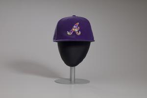 Purple Atlanta Braves baseball cap owned by Big Boi