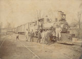 Men standing in front of a train, probably part of the Southern Railway.