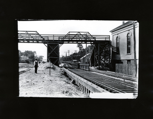 Man standing on the tracks at Newton Station of the Boston and Albany Railroad, Newton, Mass., Sept. 9, 1896