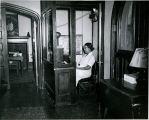 Maid at bells desk