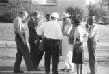 Representative Alton Turner, James Kolb, and others, talking outside during a civil rights demonstration in Luverne, Alabama.