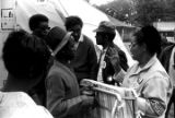 Dorothy P. Williams giving a folding cot to a man in Resurrection City, an encampment of tents and shacks constructed on the National Mall in Washington, D.C., during the Poor People's Campaign.