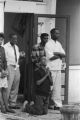 African Americans in front of the Silver Sands Restaurant across the street from 16th Street Baptist Church in Birmingham, Alabama, after the church was bombed.