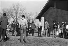 Martin Luther King, Jr., and others standing outside a small rural church building in Greenville, Alabama.