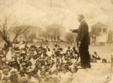 """Booker T. Washington speaking to a crowd of African Americans, giving his """"Atlanta Compromise"""" speech."""
