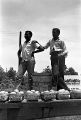 Two African American boys at a produce stand, watching participants in the March Against Fear near Senatobia, Mississippi.