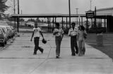 African American students on the sidewalk outside of Banks High School in Birmingham, Alabama, during the integration of the school.