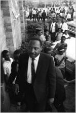 Martin Luther King, Jr., entering a building, probably First Baptist Church in Eutaw, Alabama.