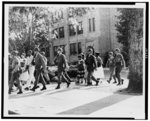 [A group of African-American students leaving Central High School, under trooper escort, Little Rock, Arkansas]