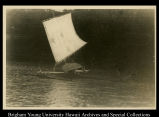 Outrigger sailing out
