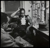 Canada Lee ponders question by Langston Hughes backstage