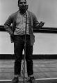 Wendell Wilkerson speaking during a meeting in the Tuskegee Institute gymnasium, which was held to discuss student demonstrations protesting the murder of Samuel L. Younge.