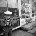Jasper Wood Collection: Boy standing outside store