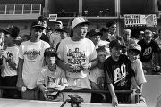 Boys watching Bo Jackson play during a Birmingham Barons baseball game in Birmingham, Alabama.
