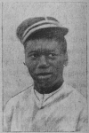 Haitian man wearing a kepi