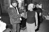 Aaron Neville and a woman backstage at the Montgomery City Auditorium during a performance of the Otis Redding Show.