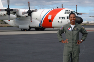 U.S. Coast Guard LT. j.g. Jeanine McIntosh, Pilot, the first female African-American to successfully complete flight training, stands in front of a U.S. Coast Guard HC-130H Hercules patrol aircraft on Jan. 2, 2006, that she will pilot on service missions throughout the Pacific region, while stationed at Coast Guard Air Station Barbers Point, Oahu, Hawaii. (U.S. Coast Guard photo by Public Affairs SPECIALIST 2nd Class Jennifer Johnson) (Released)