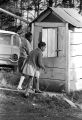 Two girls standing outside a small wooden outbuilding in the yard of Mt. Moriah Baptist Church in Hayneville, Alabama, during the first anniversary celebration of the Lowndes County Christian Movement.