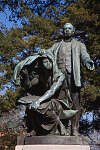 """Statue of Booker T. Washington """"Lifting the Veil of Ignorance,"""" by Charles Keck located at Tuskegee University in Tuskegee, Alabama"""