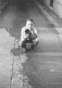 Boy with catcher's mit.