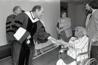 Singer Marian Anderson shaking hands with a university official