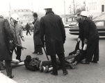 James Forman and other protestors being carried away by the police during a sit-in on Dexter Avenue in front of the Capitol in downtown Montgomery, Alabama.