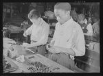 Manpower. Negro bomber plant workers. Americans of various racial groups provide manpower for war industries. These youths, employees in a large Eastern bomber plant, are assembling bomb indicators. Both are graduates of government war training courses. Glenn L. Martin Bomber Plant. Baltimore, Maryland