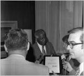 Governor Jimmy Carter with Dr. Benjamin E. Mays being interviewed by WSB after recieving the Outstanding Older Georgian Award, Morehouse College, Atlanta, Georgia, August 6, 1971.