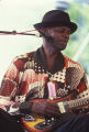 Robert Thomas playing the guitar at the 1990 Alabama Folklife Festival in Birmingham, Alabama.