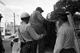 Thumbnail for Police officers arresting a civil rights demonstrator during the Children's Crusade in Birmingham, Alabama.