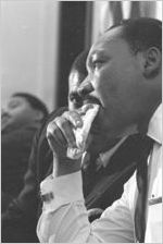 Martin Luther King, Jr., seated during a meeting at Maggie Street Baptist Church in Montgomery, Alabama.