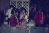 People celebrating during a New Year's party, probably at a bar in Montgomery, Alabama.