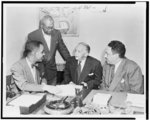 NAACP big four--top executives of the National Association for the Advancement of Colored People confer on a policy problem. Seated, left to right: Roy Wilkins, administrator; Walter White, executive secretary; Thurgood Marshall, special counsel. Henry Lee Moon, director of public relations, is standing
