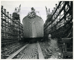 Bow-side view of Liberty ship SS Frederick Douglass sliding down the ways on the day of its launching