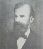 A black and white image of Bernard Mallon, Massie School's first principal