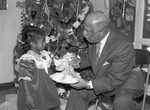 Children's Collective guest Gilbert Lindsay receiving a gift., Los Angeles, 1987